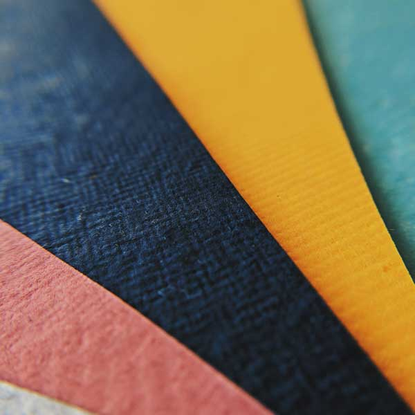 handmade papers - red. blue, yellow, green